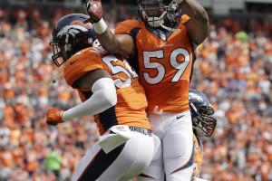 Denver Broncos inside linebacker Brandon Marshall (54) and Danny Trevathan (59) celebrate a sack against the Baltimore Ravens during an NFL football game between the Denver Broncos and the Baltimore Ravens Sunday, Sept. 13, 2015, in Denver. Denver beat Baltimore 19-13. (AP Photo/Jack Dempsey)