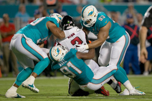 Aug. 29, 2015 - Miami Gardens, Florida, U.S. - Miami Dolphins defensive end Olivier Vernon (50), Miami Dolphins defensive end Cameron Wake (91) and Miami Dolphins defensive tackle Ndamukong Suh (93) sack Atlanta Falcons quarterback Matt Ryan (2) at Sun Life Stadium in Miami Gardens, Florida on August 29, 2015