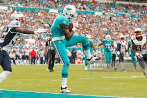 Miami Dolphins wide receiver DeVante Parker (11) scores as New England Patriots free safety Devin McCourty (32) fails to defend during the second quarter on Sunday, Jan. 3, 2016, at Sun Life Stadium in Miami Gardens, Fla. (Al Diaz/Miami Herald/TNS)