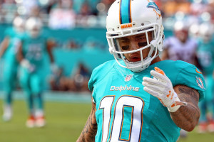 Jan 3, 2016; Miami Gardens, FL, USA; Miami Dolphins wide receiver Kenny Stills (10) reacts during a game against the New England Patriots at Sun Life Stadium. The Dolphins won 20-10. Mandatory Credit: Steve Mitchell-USA TODAY Sports